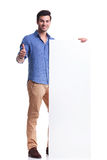 Man presenting a big board and makes the ok sign Stock Images