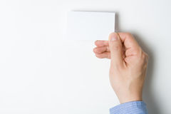 Man presenting business card Royalty Free Stock Images