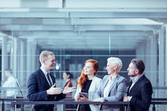 Man presenting business offer. To group of clients Stock Photo