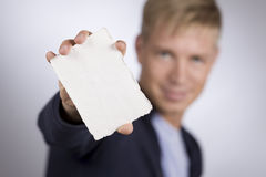 Man presenting empty white card. Royalty Free Stock Images