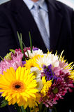 Man presenting flowers Royalty Free Stock Photos