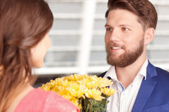 Man Presenting Flowers To His Girlfriend Stock Image