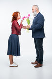 Man presenting flowers to woman Royalty Free Stock Photography