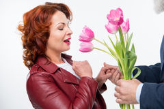 Man presenting flowers to woman Royalty Free Stock Images