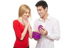 Man presenting gift in box to girl Stock Photography