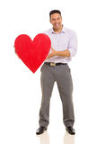 Man presenting heart symbol Royalty Free Stock Photography