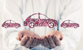 Close up of male hand showing car symbol made with gears and cog Royalty Free Stock Photography
