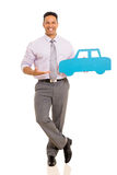 Man presenting paper car Royalty Free Stock Photos