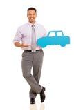 Man presenting paper car. Cheerful mid age man presenting paper car isolated on white background Royalty Free Stock Photos