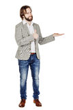 Man presenting or showing something your text or product. human. Bearded man presenting or showing something your text or product. human emotion expression and Stock Photography