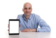 Man presenting something on a digital tablet Stock Photo