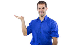 Man Presenting Something. Young businessman in blue collar shirt isolated on a white background stock photography