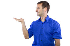 Man Presenting Something. Young businessman in blue collar shirt isolated on a white background stock photo