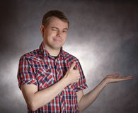 Man presenting something. Young man presenting something on hand Royalty Free Stock Photo