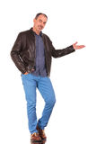 Man presenting standing with one hand in pocket Royalty Free Stock Photography