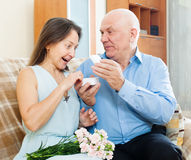 Man presenting surprised woman jewel Stock Photo