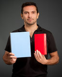 Man presenting two objects Stock Image