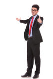 Man presents in the back & shows ok Royalty Free Stock Photos