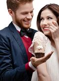 Man presents birthday cake to his girlfriend who likes it Stock Image