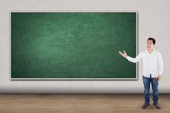 Man presents empty blackboard Royalty Free Stock Image