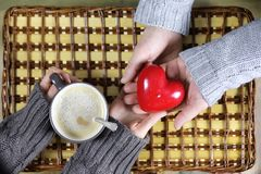 Man presents girl drinks coffee gift on Valentine`s Day Royalty Free Stock Photos