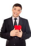 Man presents heart in Valentine day Royalty Free Stock Photo