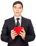 Man presents heart in Valentine day Royalty Free Stock Images