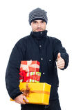 Man with presents thumbs up Royalty Free Stock Image