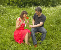 Man presents woman red rose Stock Image