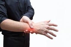 Man press painful hand Stock Photos