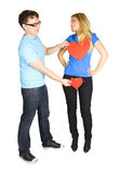Man press two paper hearts to blond girl Stock Images