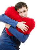 A man pressed against a big red heart Royalty Free Stock Photos