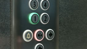 Man presses a button the first floor and a button closing elevator doors stock video