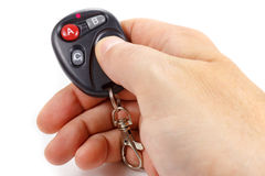 Man presses button on the garage door remote control Stock Images