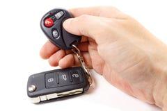 Man presses button on garage door remote control Royalty Free Stock Photos