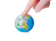 Man presses his finger on the globe Stock Photos