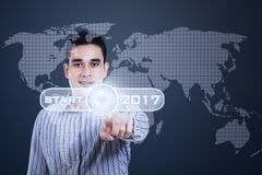 Free Man Presses Start Button With 2017 Royalty Free Stock Photo - 79263435