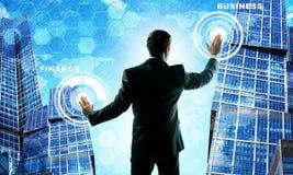 Man presses virtual toush screen. Skyscrapers Stock Photography
