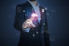 Man pressing button at virtual interface Stock Photo