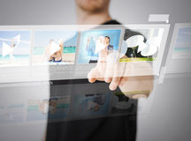 Man pressing button on virtual screen Stock Photography