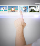 Man pressing button on virtual screen Royalty Free Stock Photos