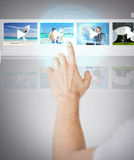 Man pressing button on virtual screen Royalty Free Stock Photo