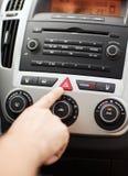Man pressing car hazard warning button. Transportation and vehicle concept - man pressing red triangle car hazard warning button royalty free stock photo