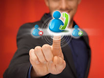 Man pressing contact icon Royalty Free Stock Images