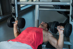 Man Pressing Dumbbells Royalty Free Stock Image