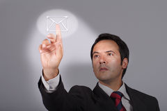 Man pressing email button Stock Photo