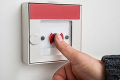 Man pressing emergency button Stock Images