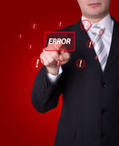 Man pressing ERROR button Stock Image