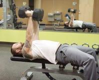 Man Pressing Fifty Pound Dumbbells Stock Photos