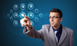 Man pressing high tech type of modern buttons. Businessman pressing high tech type of modern buttons on a virtual background Stock Photos